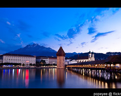 Luzern, Switzerland (Popeyee) Tags: pictures old city travel bridge blue sunset mountain lake alps reflection tower water architecture night river schweiz see photo wooden twilight europa europe foto photographer image symbol photos footbridge watertower picture luzern chapel landmark visit images tourist mount pilatus german fotos hour stadt bluehour bild brcke lucerne canton wasserturm bilder lucerna attraction vierwaldstttersee kapell attractions swissalps chapelbridge brucke kapellbrucke truss kapellbrcke reuss rigi mountpilatus mtpilatus 2011 lozrn reussriver swissswitzerland popeyee sttt