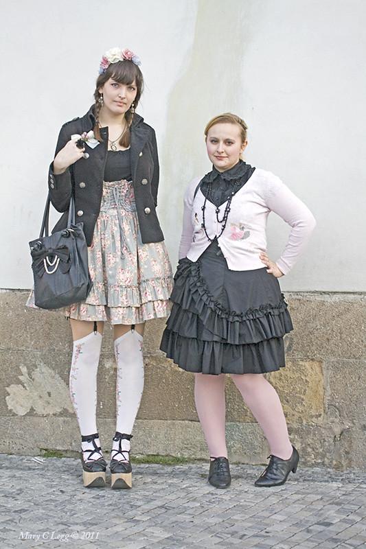 Fashion divas poseon Old Town Square.
