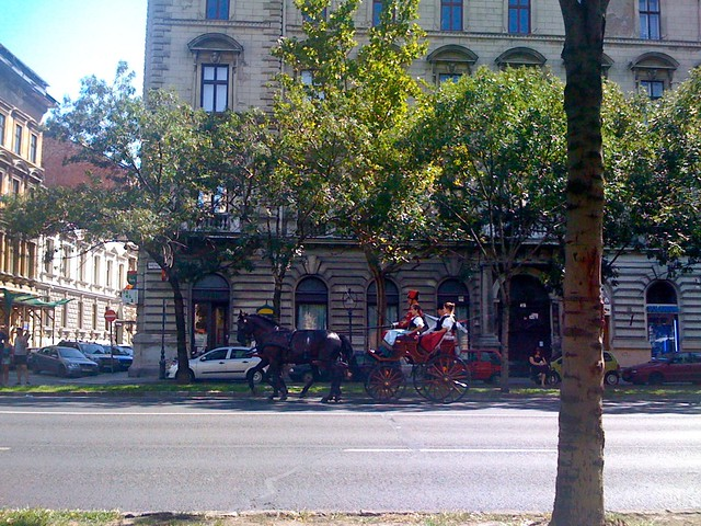 Hungarian in Folk costumes on horse carriages in Budapest
