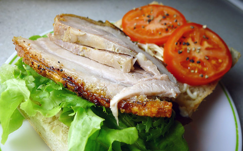 pork belly, lettuce and tomato sandwich