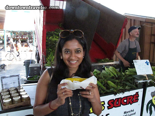 Eating fresh corn at Jean Talon Market in Montreal