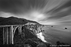 Bixby Bridge (Silent G Photography) Tags: ocean california ca longexposure bridge blackandwhite bw cliff mountains coast pacific bigsur pch highway1 le marinelayer bixbybridge pacificcoasthighway cloudmovement sigma1020 10stopndfilter bwnd110 nikond7000 markgvazdinskas silentgphotography