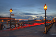 An Evening on Skeppsholmen XI (Henrik Sundholm.) Tags: city bridge sunset people sign clouds boats shadows traffic sweden stockholm palace lighttrails sverige lamps hdr strmmen slottet skeppsholmsbron