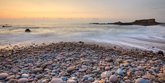 Summerleaze Beach (peter.guyan) Tags: sunset beach water canon eos rocks cornwall waves pebbles lee milky 1635mm 10stop summerleaze leefilters 5dmkii bigstopper