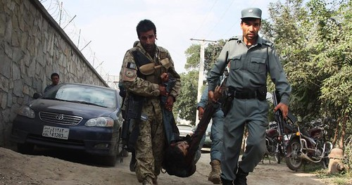 US-NATO puppet Afghan forces carry away body in the aftermath of the resistance attack on the American embassy in Kabul. The Taliban has escalated the resistance with coordinated attacks during the second week in September 2011. by Pan-African News Wire File Photos