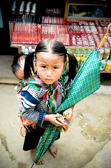 Child with large shoes to fill (Huey Yoong) Tags: boy baby girl umbrella children infant asia southeastasia child vietnam barefeet pigtails traditionalcostume brolly environmentalportrait childrensportrait peopleportrait 5photosaday hmongtribe northvietnam nikkor18200mmvr nikond300