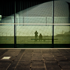 The Cage of Glass (Gilderic Photography) Tags: city shadow people urban woman cinema man reflection window glass silhouette architecture self canon square eos hall concert europe raw mood geometry vertigo structure symmetry ombre minimal line story reflet illusion future abstraction curve luxembourg cinematic fenetre kirchberg verre buiding lightroom vitre philharmonie geometrie carre 500d 500x500 philharmonics gilderic