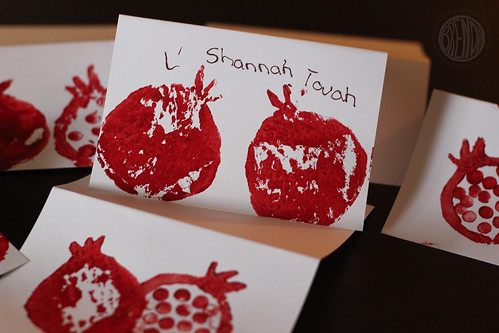 picture of kidmade Rosh Hashanah cards with painted pomegranates and wishes for L' Shana Tovah