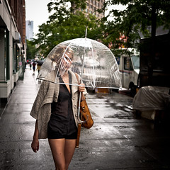 Transparency (sjmgarnier) Tags: street newyorkcity people urban woman usa newyork water rain june umbrella walking rainyday manhattan sidewalk rainy transparency transparent portfolio protection youngwoman 6thavenue fashionable avenueoftheamericas waverlyplace 2011 washingtonplace transparentumbrella transparentclothes colorstreetphotography fashionablewoman transparentshirt