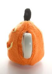 Halloween Pumpkin Face Tea Cosie (GezuntehMoid) Tags: orange man halloween wool goofy pumpkin knitting moody happyface teacozy sadface bluehat reversable teapotwarmer teacosie twofacedman stroppybloke smilingandsad