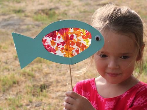 girl and her fish puppet