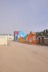 Sandy Street (Paul McGhie) Tags: road sand colourfulbuildings luderitz sandystreet