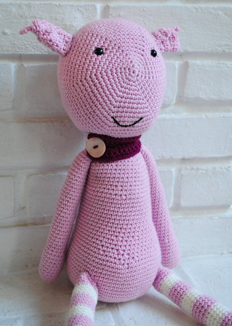 Crochet creature wearing scarf