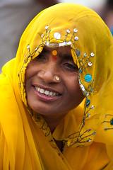 Woman in Yellow (Dick Verton) Tags: travel woman india yellow asia veiled varanasi