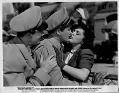 Flight Angels (addie65) Tags: kissing couple feathers 1940s gloves uniforms pilots moviescene vintagedress classicfilm classichollywood dennismorgan waynemorris virginiabruce flightangels deceasedactors