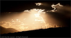 Wind power backlit by solar power (Kurt Lawson) Tags: california ca sun mountains backlight clouds contrast power unitedstates wind 14 mojave beams windturbine turbines godrays solarpower highway14 kurtlawson