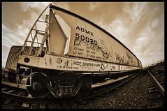 Train (BHagen) Tags: old sky urban brick abandoned industry broken sepia train graffiti washington nikon spokane factory grunge border tracks gritty fisheye worn destroyed spokanewa d90 prooptic