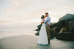 Mike & Caitlin | Wedding | Coronado Island (KelsieTaylor) Tags: ocean wedding sunset love beach kiss kissing couple rocks photographer veil sandiego coronado brideandgroom hairpiece coronadoisland weddingphotographer sandiegoweddingphotographer kelsietaylor
