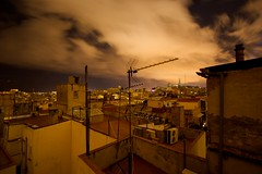 Clouds over Barcelona (jeroen_bennink) Tags: barcelona city longexposure light vacation urban holiday tourism architecture night clouds canon geotagged outside eos lights licht vakantie spain nightshot nacht wolken roofs deserted antenne antenna stad architectuur spanje tourisme donker daken laribera verlaten langesluitertijd nachtopname eos400d canoneos400d