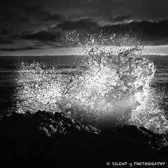 Coming in Hot (Silent G Photography) Tags: california ca sunset blackandwhite bw water clouds contrast rocks waves crash pismobeach shellbeach oceanblvd fastshutter colorefexpro lightroom3 nikond7000 nikkor1635mmf4 markgvazdinskas silentgphotography