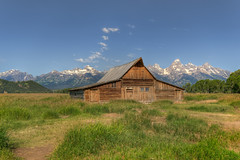 T. A. Moulton Barn on Mormon Row in front of the Grand Tetons (Carl's Photography) Tags: blue sky orange mountains tree green grass horizontal clouds landscape iso100 nikon outdoor horizon tripod bracket bluesky processing wyoming gps f11 hdr scenics lightroom bracketing grandtetonnationalpark sigma1020mm grandtetonmountains mormonrow beautyinnature photomatixpro sigma1020mmf456exdchsm adobelightroom moultonbarn 1200sec d