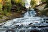 From Below (Michigan Nature Photog) Tags: autumn trees fall water yellow waterfall rocks michigan seasonal flowing upperpeninsula