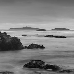 Rocks of Aberdaron (Anthony Owen-Jones) Tags: ocean uk longexposure sea blackandwhite bw cloud seascape black beach nature water monochrome wales clouds canon lens landscape eos rebel mono bay coast landscapes photo seaside kiss europe long exposure moody natural unitedkingdom north gimp naturallight filter photograph nd kit postprocess bnw gwynedd hoya pwllheli t3i x5 northwales 600d takenwith nd16 canonefs1855mmf3556is rebelt3i kissx5