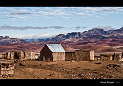 Barren Existence (Steve Rosset) Tags: poverty africa wood travel roof camp house mountains home landscape geotagged tin village open desert earth space wide may rocky hills exotic peaks shelter accommodation geo barren namibia basic settlement 2011 steverosset touraroundtheworld visipix geoafrica