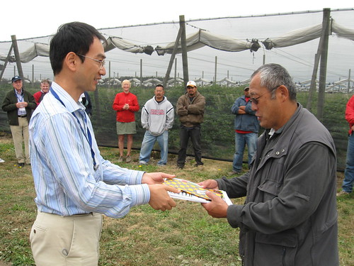 Katsuhiro Saka of Japan (left) thanks Steve Sakuma (right) of Sakuma Brothers Farms for hosting the tour at his fruit operation.  Steve raises strawberries, raspberries, and blueberries.