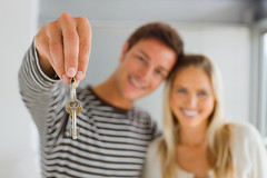 Smiling boy holding house keys by his girlfriend (itsdstuart) Tags: new family girls two woman house man blur male men home girl smile smiling set female happy person holding hands women couple key hand estate sale background property happiness move together deal bunch males casual concept females conceptual residential success purchase hold own owner relocate ownership satisfied homeowner purchasing successful