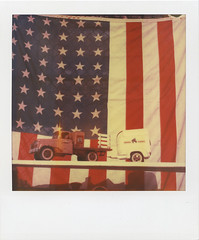 1 Tonka truck - original decals; 1 sovereign nation - some parts missing, needs work (davebias) Tags: truck polaroid sx70 flag american squareformat expired fleamarket tonka timezero exp03