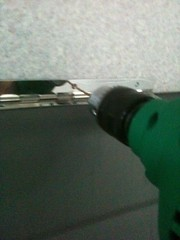 drilling to make a screw hole