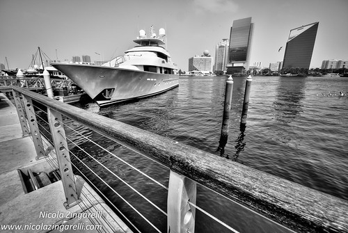Dubai, large yacht moored at the dock with the city behind it. Fake HDR, 3 exposures +2 and - 2ev by Nicola Zingarelli