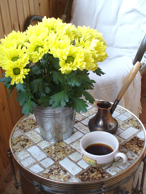 yellow chrysanthemums and coffee