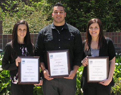 Fresno State University students Caitlin Guest (far left), Aki Dionisopoulos (center), and Amanda Jo Bettencourt (right) receive plaques from AMS.   These students were the 2011 recipients of the AMS Assistantship.  All three currently work with AMS.