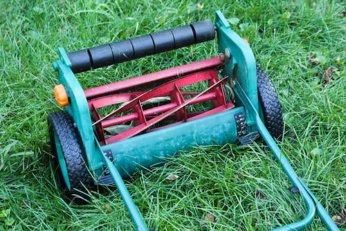 red green grass yellow lawn push mower