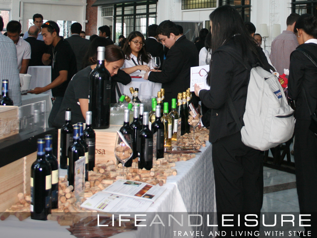 Crowd inside the Atrium taking part in Enderun's wine tasting event