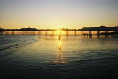cheesy cliché brighton nonsense (lomokev) Tags: summer sun reflection beach silhouette yellow pier brighton mju olympus westpier lowtide agfa ultra agfaultra brightonpier olympusmju olympusmjuii olympusmju2 posted:to=tumblr file:name=110930olympusmjuiiagfaultra24 roll:name=110930olympusmjuiiagfaultra