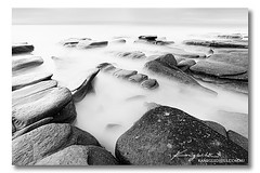 Pebbles ([ Kane ]) Tags: ocean seascape black contrast rocks waves brisbane sharp sunshinecoast noosaheadland kanegledhill wwwkanegledhillcomau bwblackandwhiteqldqueensland