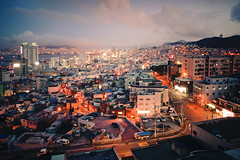 Urban View: the Republic of Korea's Second Largest City (United Nations Photo) Tags: city urban panorama lights evening nikon asia view korea aerial busan unitednations population southkorea unphoto