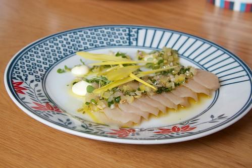 Raki cured kingfish preserved lemon, orange blossom and popcorn shoots