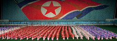 North korean flag during Arirang - Pyongyang North Korea (Eric Lafforgue) Tags: war asia korea asie coree northkorea dprk coreadelnorte 7073 nordkorea    coreadelnord   insidenorthkorea  rpdc  kimjongun coreiadonorte