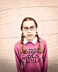 Inner Beauty (Victoria Hederer Bell) Tags: school cute brick nerd girl beauty smart wall lensbaby canon glasses funny humorous braces fisheye braids sweatshirt comical cliche composer intelligent headgear brainy 40d ourdailychallenge odc3 victoriahedererbell