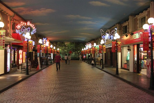 Rows of outlets which sell clothing, bags and food in People's Square underground mall, Shanghai, China