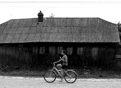ice-cream on a bike (oana-emilia) Tags: boy bw monochrome bicycle rural fence fences oldhouse icecream romania friday fenced odc neamt sabaoani ourdailychallenge fencedfriday