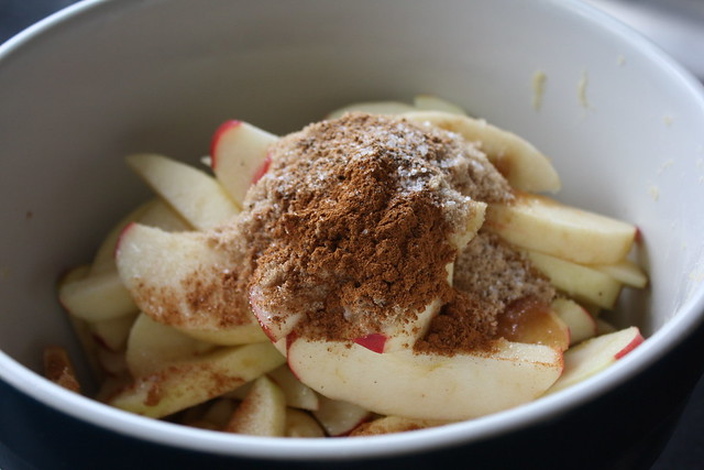 nutmeg, cinnamon, sugar on apples