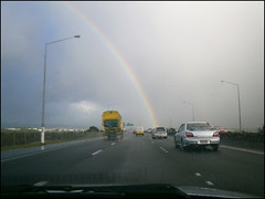Driving on SH16 with a rainbow