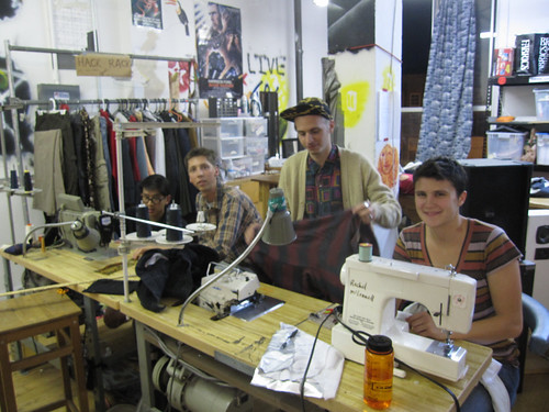 sewing area with smiley people doing things