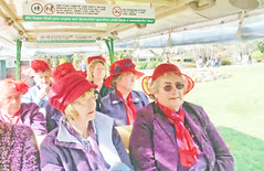 The Ladies day out (Steve Taylor (Photography)) Tags: park trip ladies red newzealand christchurch hat lady outfit tour hats canterbury caterpillar nz southisland guide botanicalgardens redhatsociety hagley redrascals