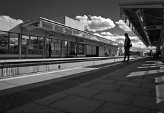 The Price of Love (Sven Loach) Tags: uk england bw man station clouds contrast canon waiting afternoon shadows britain platform streetphotography sunny reflective publictransport overground neworder g12 haggerston londonist